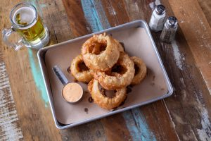 HAND-DIPPED ONION RINGS